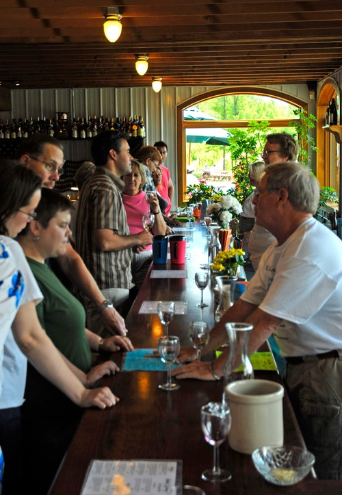 Photo of our team serving guests in our Tasting Room